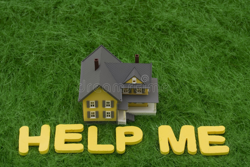 Mortgage Crisis. House with the words help me on grass. mortgage crisis stock image