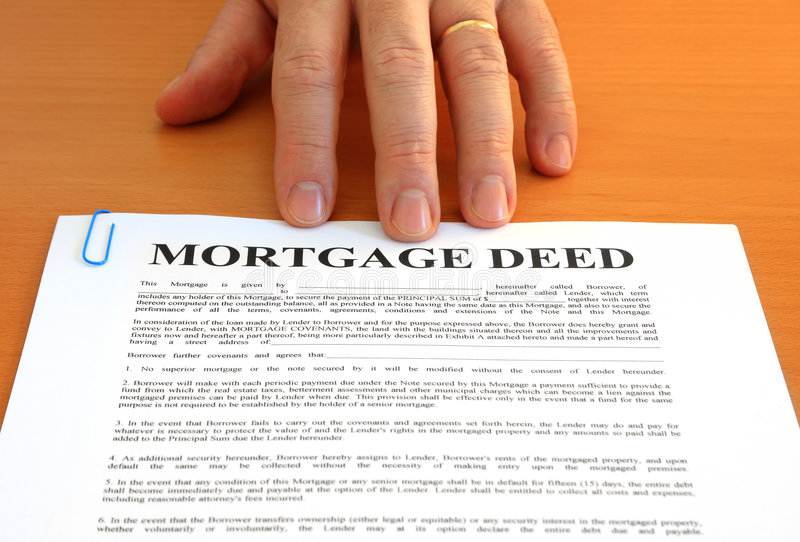 Mortgage Deed and Hand. Male hand presents a mortgage document royalty free stock photography