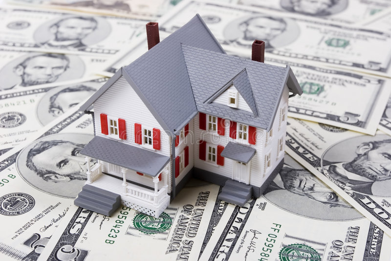 Mortgage and down payment. Two-story house with five dollar bills background stock image