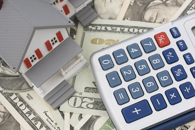 Mortgage and Down Payment. House on American currency and calculator royalty free stock images