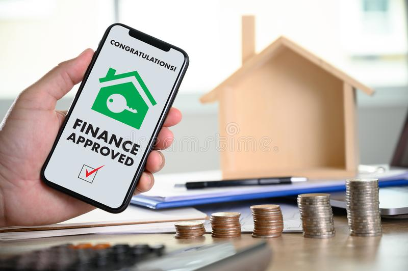 Mortgage Loan approval on mobile phone in a house contract form with approved  home ownership stock photos