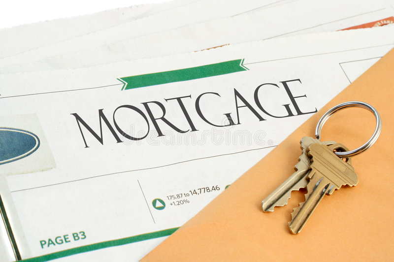 Mortgage news. Conceptual mortgage section of the newspaper with yellow envelope, and keys royalty free stock photography