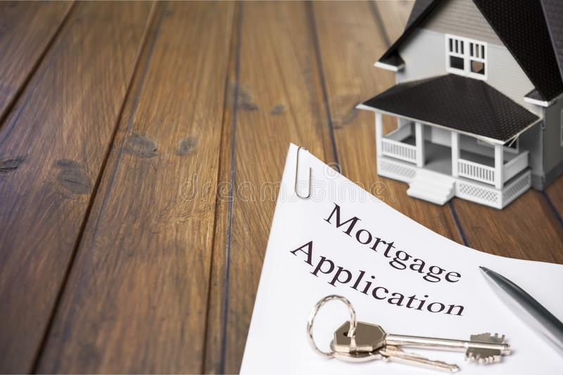 Closeup shot of mortgage papers and house. Mortgage papers background object design small sale artificial stock images