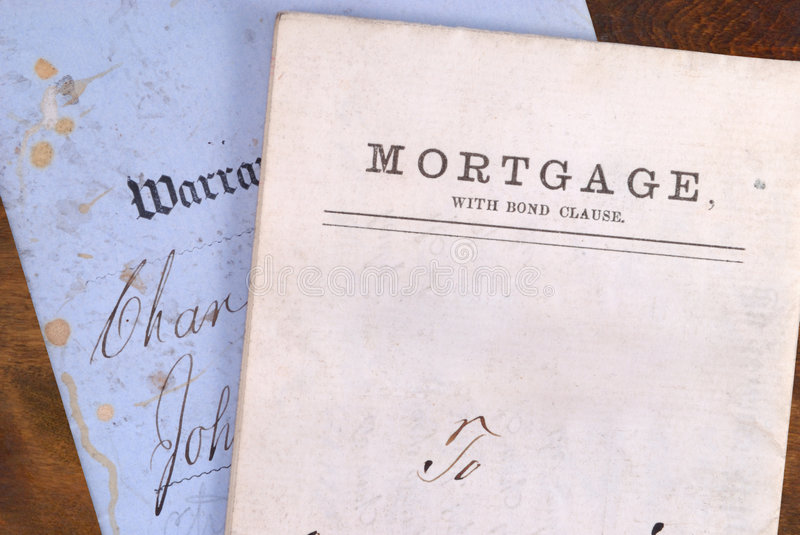 Mortgage and Warranty Deed. Vintage grungy looking mortgage and warranty deed stock image