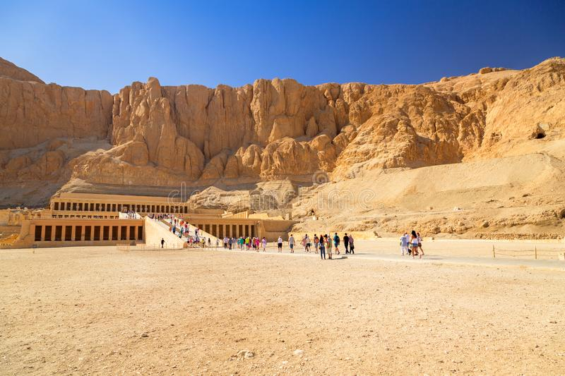 The Mortuary Temple of Queen Hatshepsut located near the Valley of the Kings. LUXOR, EGYPT - APRIL 10, 2013: Unidentified tourists at The Mortuary Temple of royalty free stock photos