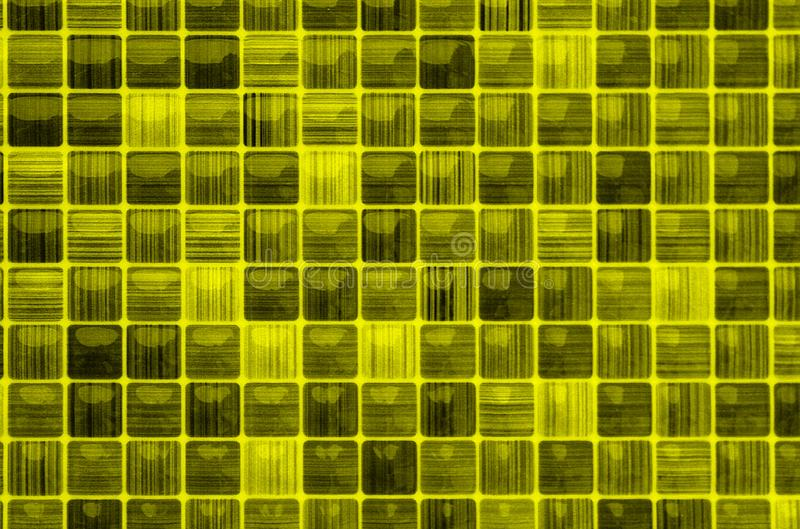 Texture small mosaic yellow color glass background. Mosaic, background, ceramic, tile, decorative, abstract, decoration, texture, design, colorful, detail royalty free stock photo