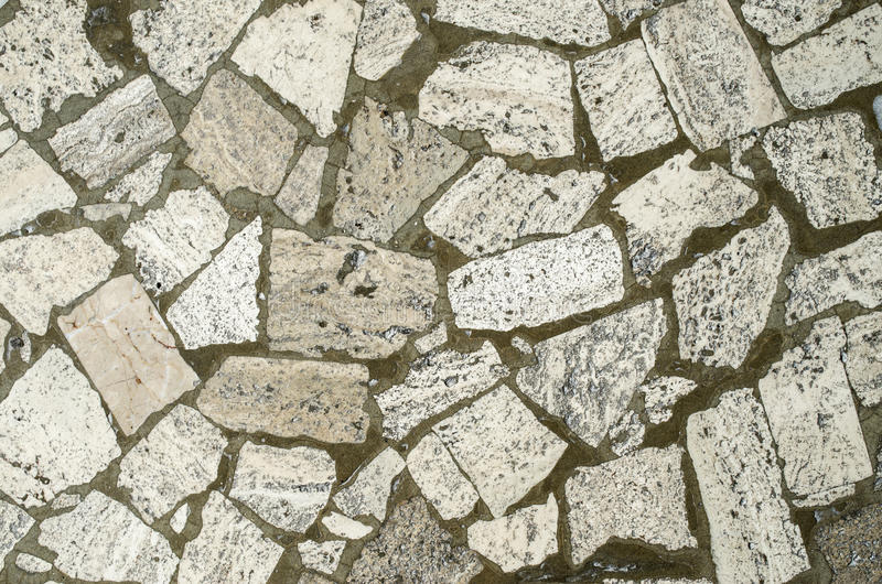 Mosaic from big stone pieces closeup. Mosaic from big stone pieces royalty free stock photos