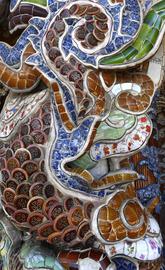 Mosaic details in the Vietnamese Ve Chai Pagoda. Linh Phuoc Pagoda or the Ve Chai Pagoda - a Buddhist dragon temple in the city of royalty free stock images