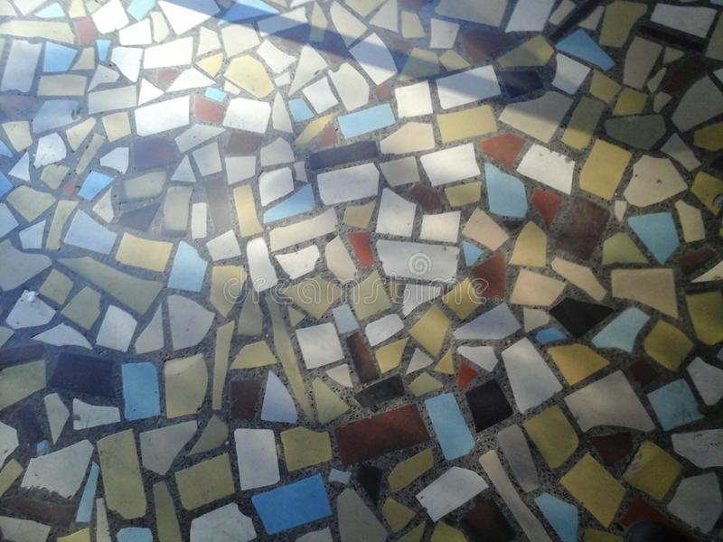 Mosaic entry. Shadow, hallway, building, geometry, red, white, yellow, blue royalty free stock photo