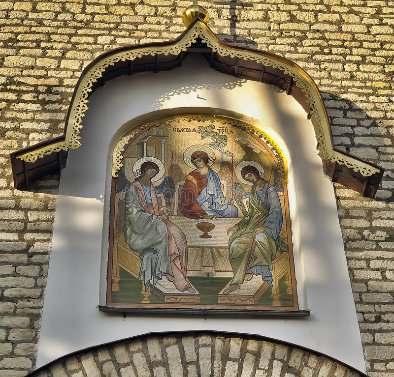 Mosaic gate icon Old Testament Trinity designed by E. Klimov and made in 1942 in Germany. Was established in 2003 above Pskov Kremlin gate royalty free stock photography