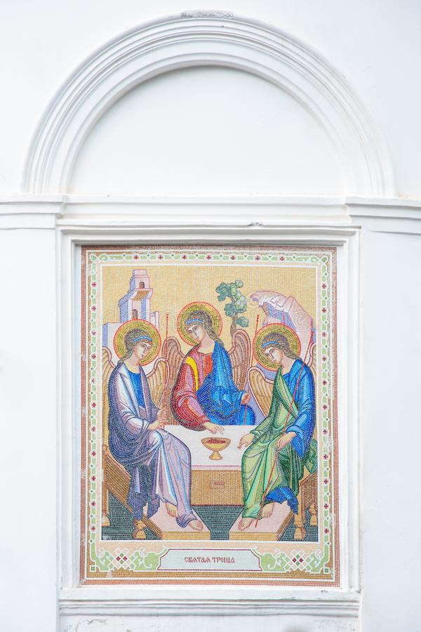 Mosaic of the Holy Trinity on the outside of the Christian Church. Holy Trinity Church in Tomsk, Russia. Translation: `Holy Trinity stock photos