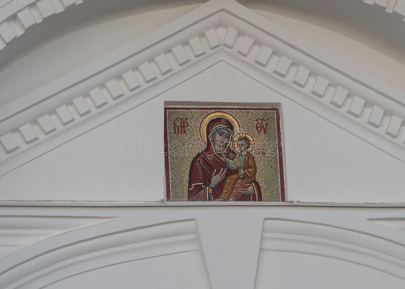 St. Petersburg, Russia - September 06, 2017: Mosaic icon on the white wall of the monastery. Mosaic icon of the Mother of God at the Valaam Monastery royalty free stock images