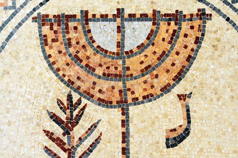 Mosaic of a Jewish menorah. An ancient mosaic design artwork of a Jewish menorah royalty free stock images