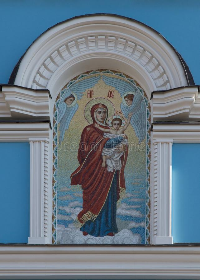 Mosaic of mother of God with Jesus Christ child in a hands royalty free stock photography