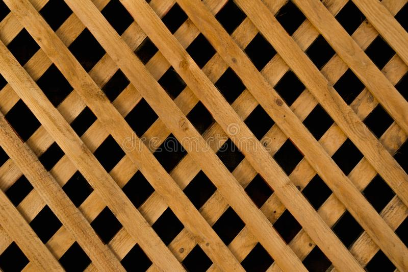 Mosaic oblique skew diagonal transverse straight symmetrical structure of wooden texture made of planks Natural hardwood floor on. A patio or deck with royalty free stock images