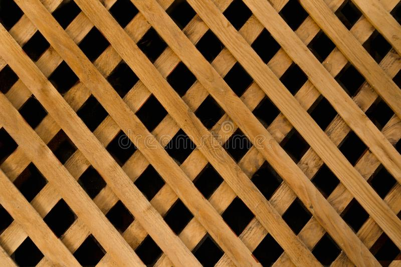 Mosaic oblique skew diagonal transverse straight symmetrical structure of wooden texture made of planks Natural hardwood floor on. A patio or deck with royalty free stock photos