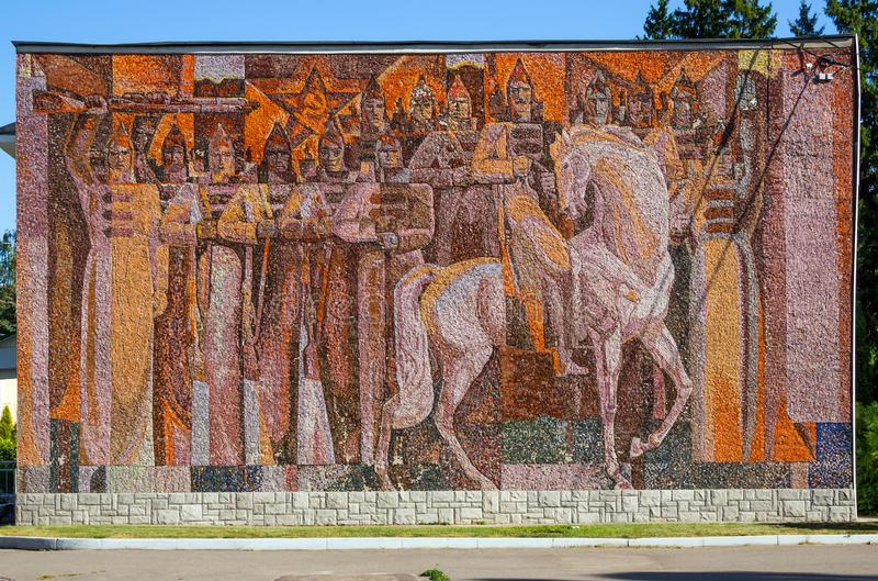 Mosaic panel on a revolutionary theme on the building of the sanatorium named after Dzerzhinsk. Voronezh, Russia - August 26, 2018: Mosaic panel on a royalty free stock image