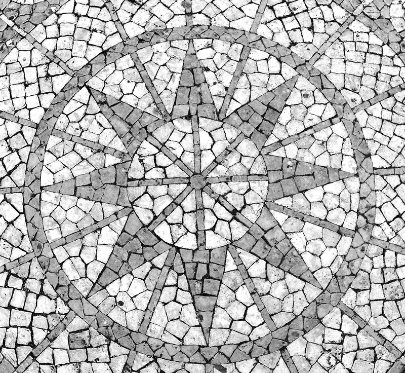 Mosaic in a Portuguese sidewalk. Featuring a wind rose stock images