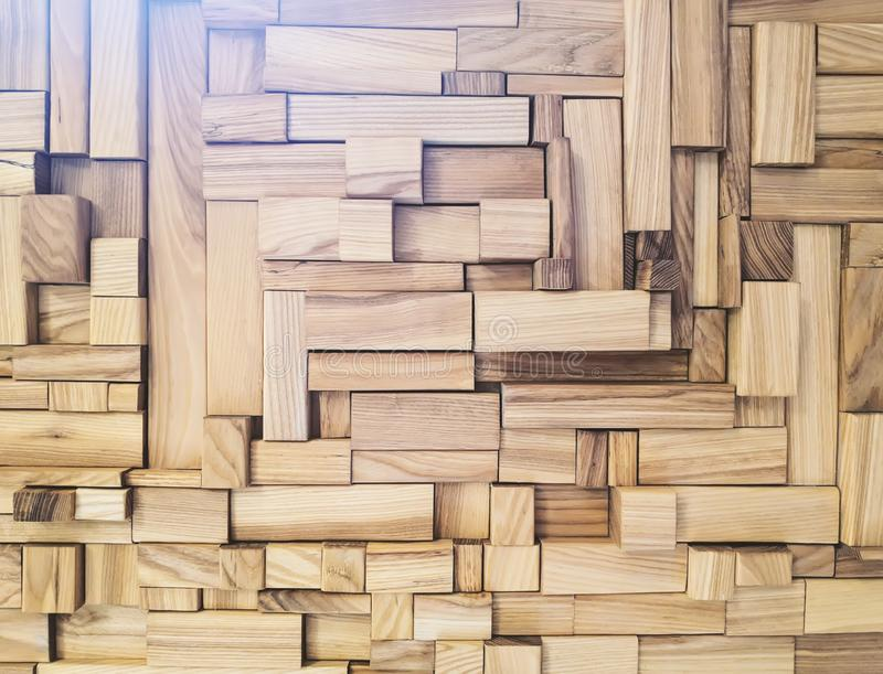 Mosaic and processed blocks of wood of different sizes, located randomly. Sunlight fills the photo above. natural structure - royalty free stock photo
