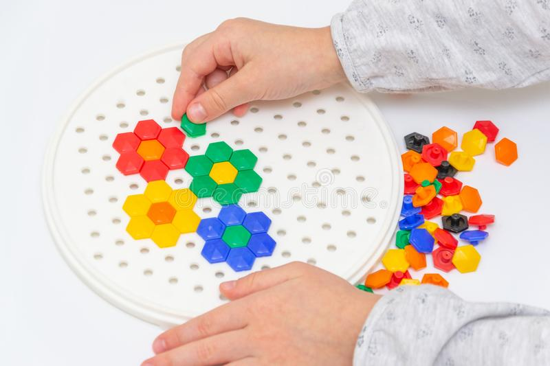 Mosaic puzzle art for kids, children& x27;s creative game. Flowers royalty free stock images