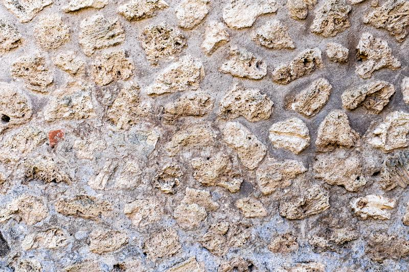 Mosaic in ruins of Ancient Roman city Pompeii, Italy. Abstract geometric chaotic pattern. royalty free stock photography