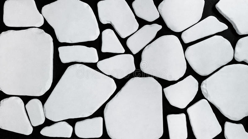 Mosaic of Seamless Pieces of Stone. Image of a mosaic made of different seamless pieces of a white stone stock photography