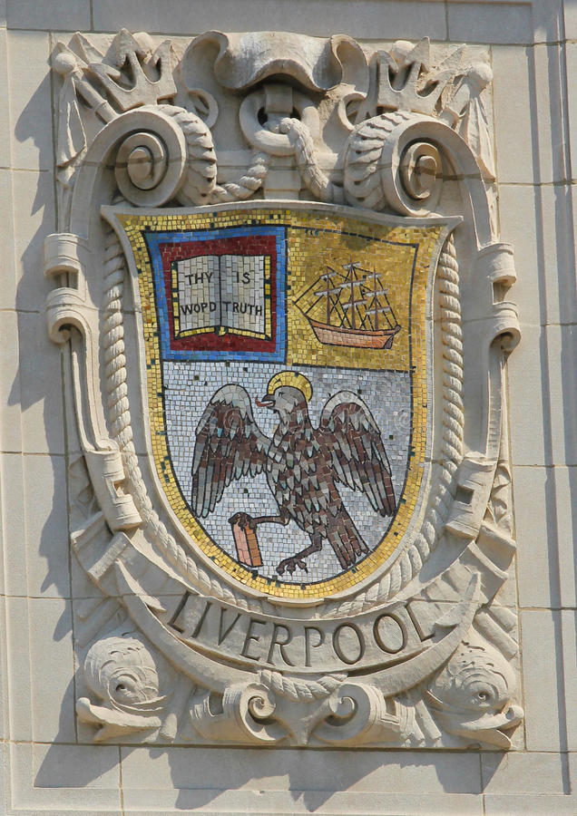 Mosaic shield of renowned port city Liverpool at the facade of United States Lines-Panama Pacific Lines Building. NEW YORK - AUGUST 6: Mosaic shield of renowned royalty free stock photos
