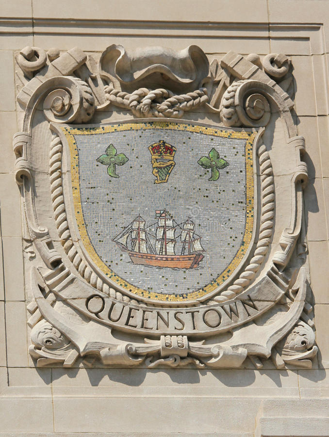 Mosaic shield of renowned port city Queenstown at the facade of United States Lines-Panama Pacific Lines Building. NEW YORK - AUGUST 6: Mosaic shield of renowned royalty free stock image