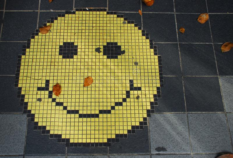 Mosaic of an smiling face emoticon stock photos
