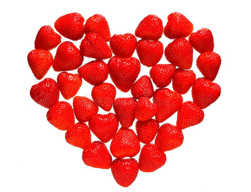 Mosaic of strawberry berries in the shape of heart. royalty free stock images