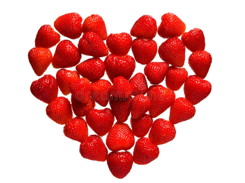 Mosaic of strawberry berries in the shape of heart. royalty free stock photo