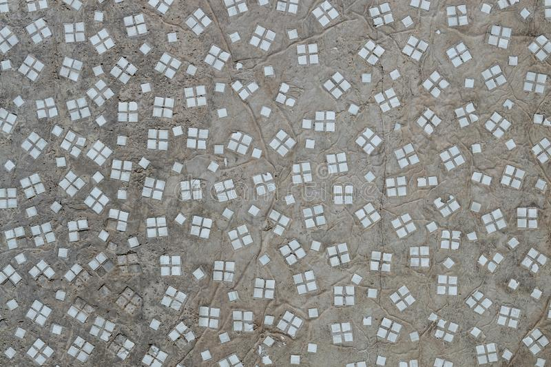 Mosaic textured on a gray concrete wall. stock image