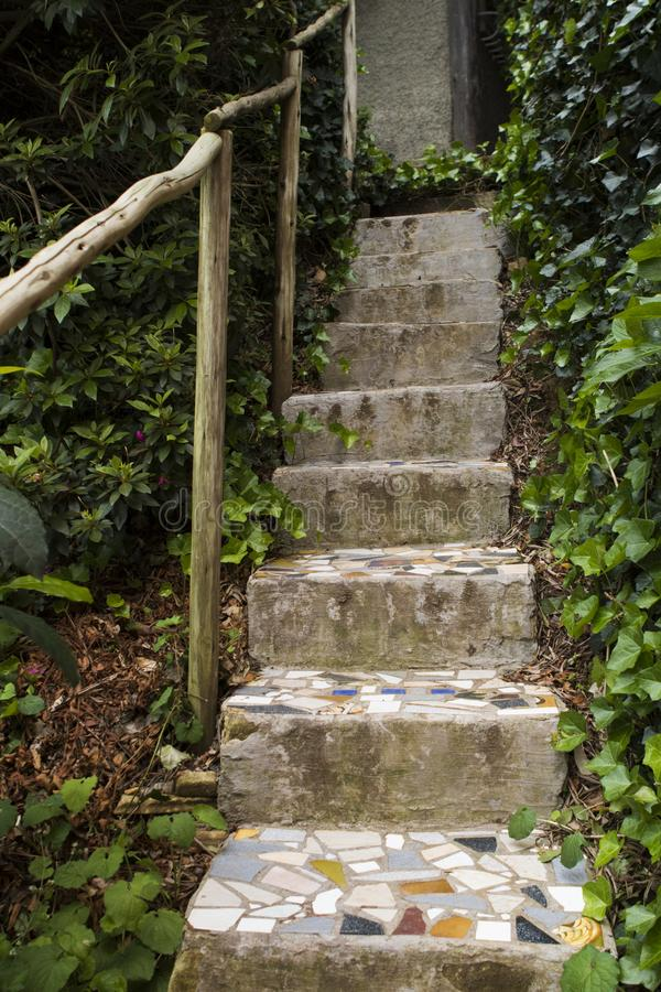 Mosaic stairs in a garden royalty free stock images