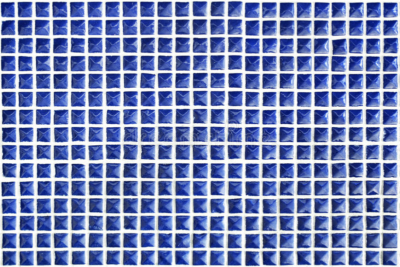 Mosaic Tiles. Blue mosaic tiles background from a wall stock image