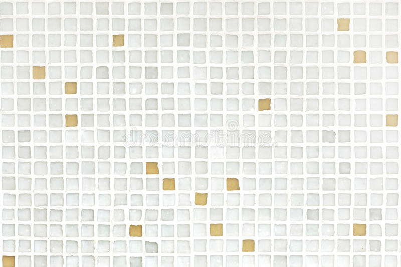 Mosaic Tiles. Beige mosaic tiles background from a wall royalty free stock photo