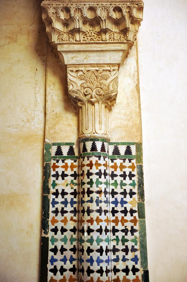 Mosaic of tiles and column, Alhambra palace in Granada, Spain royalty free stock photos