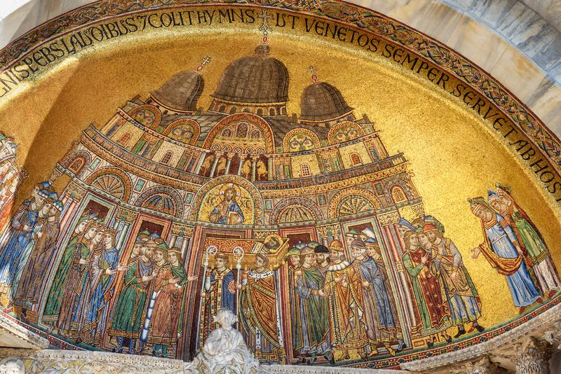 Mosaic of the translation of the body of Saint Mark on facade of Basilica of San Marco. Venice. Italy. Mosaic of the translation of the body of Saint Mark on stock photography