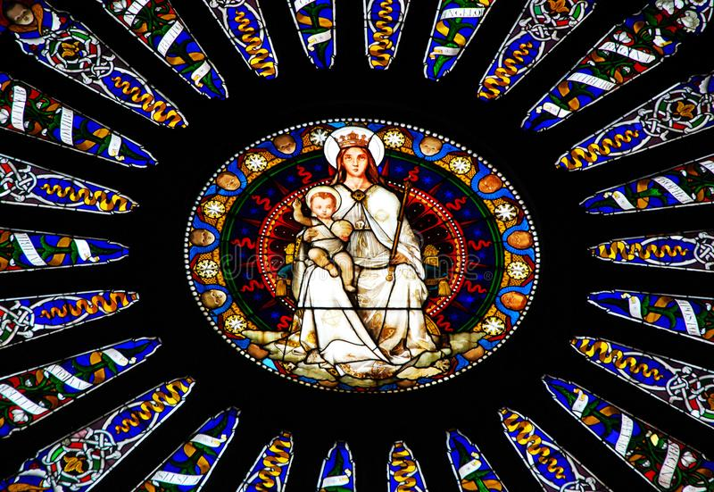 Mosaic window of cathedral of Saint Lawrence in Genoa, Italy stock photos