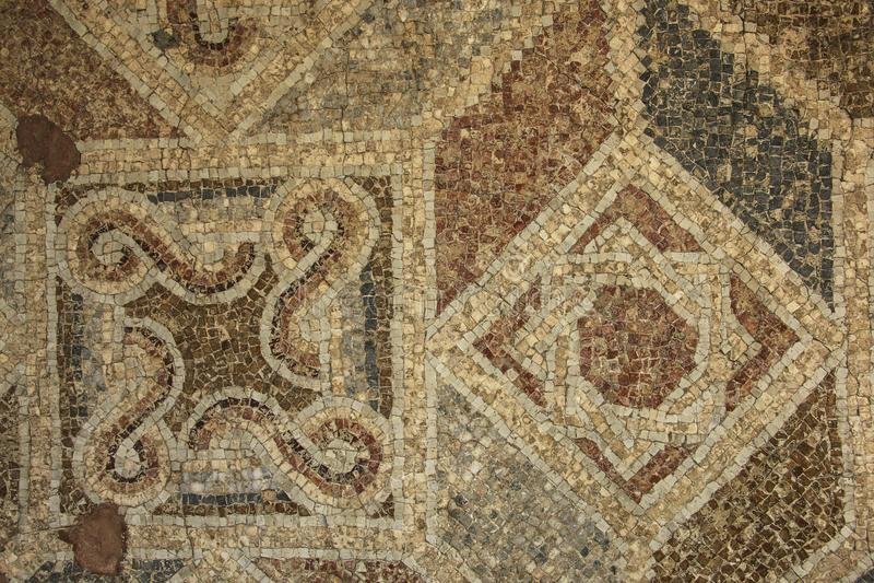 Mosaico bizantino do assoalho antigo das ruínas romanas em Umm Qais, ANC fotografia de stock royalty free