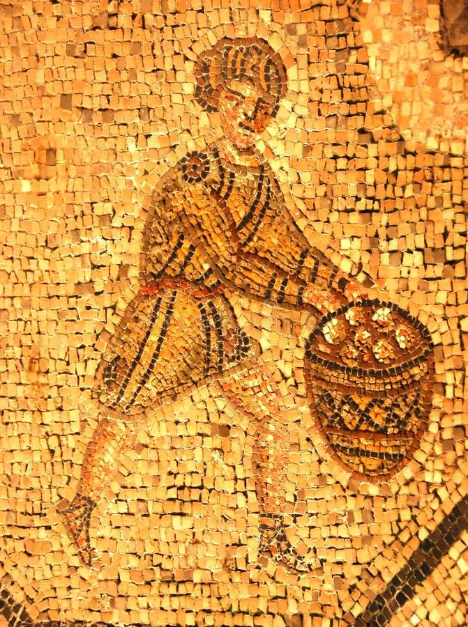 Mosaico romano antiguo de un hombre en una túnica imágenes de archivo libres de regalías
