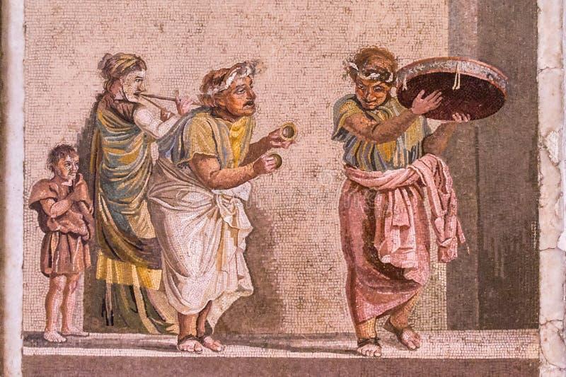 Mosaik von Pompeji, Italien, das Straßenmusiker zeigt lizenzfreie stockfotos
