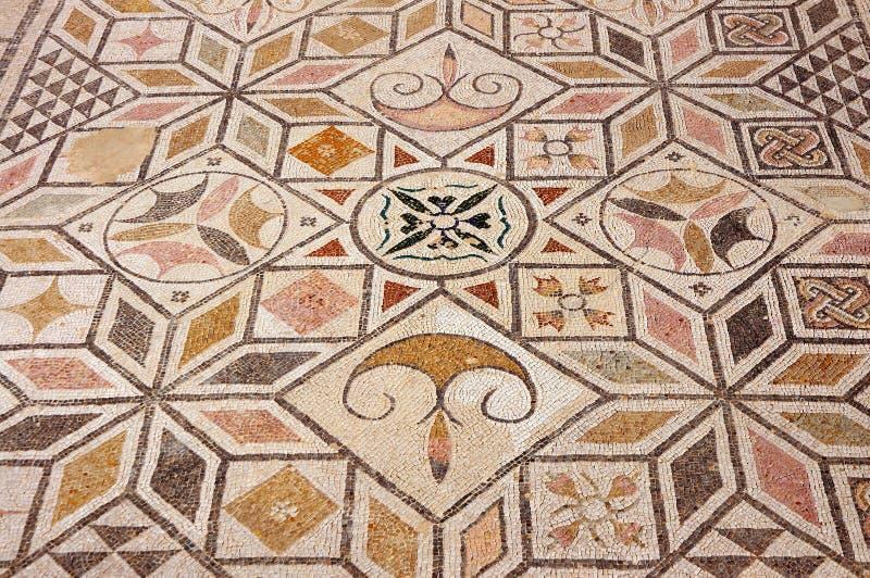 Mosaiken däckar i romaren fördärvar Italica. arkivfoto