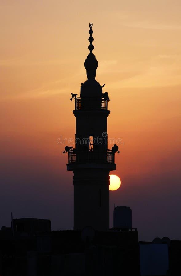 Moschee mit Sonnenuntergang lizenzfreie stockbilder