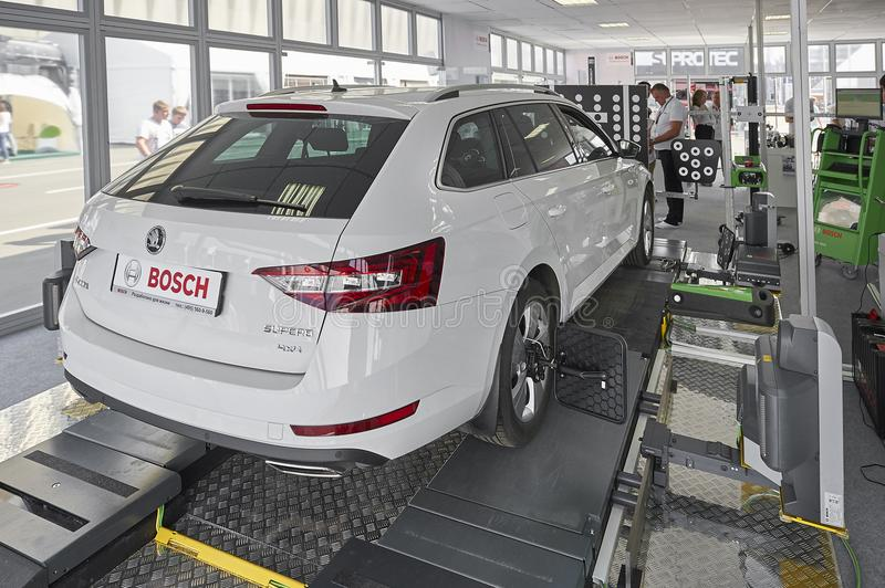MOSCOW, AUG. 22, 2017: Exhibition stand car maintenance and diagnostic equipment devices tools. Wheel alignment equipment. Car mai. Ntenance repair diagnostic stock image