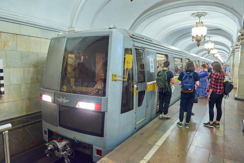 MOSCOW, AUG, 22, 2017: Modern subway passenger train at metro station and train waiting people on railway station ptatform. Perspe. Ctive view of train front stock photos