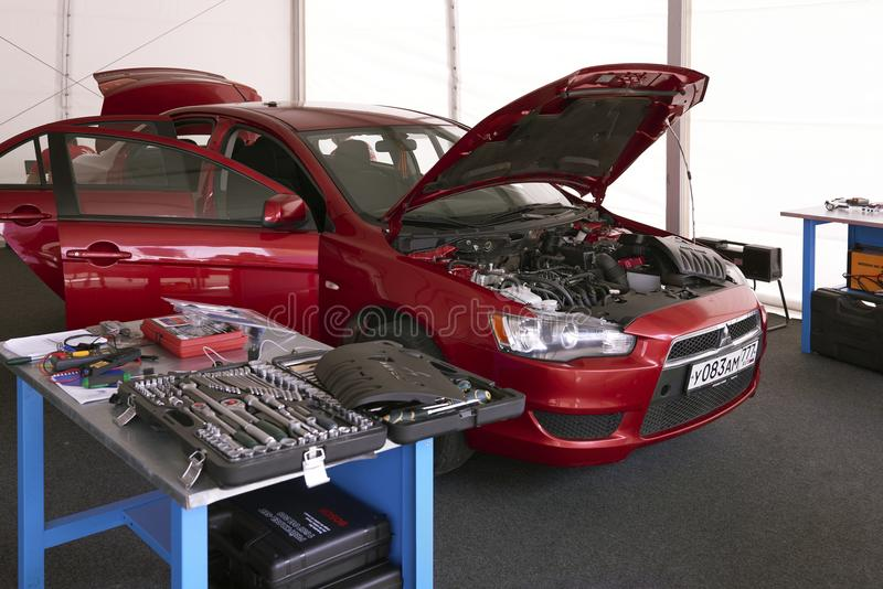 MOSCOW, AUG. 22, 2017: View on clean working place for car diagnostics and maintenance repair with new electronic equipment and ha. Nd tools. Car engine royalty free stock photography