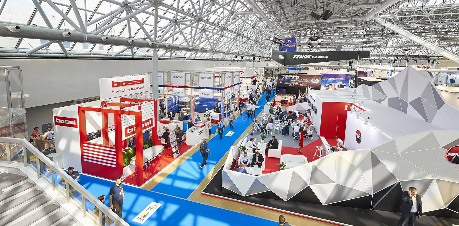 MOSCOW, AUG. 22, 2017: View on exhibition stands of car parts components details different companies Car trucks tractors parts com. Ponents details exhibition royalty free stock photos