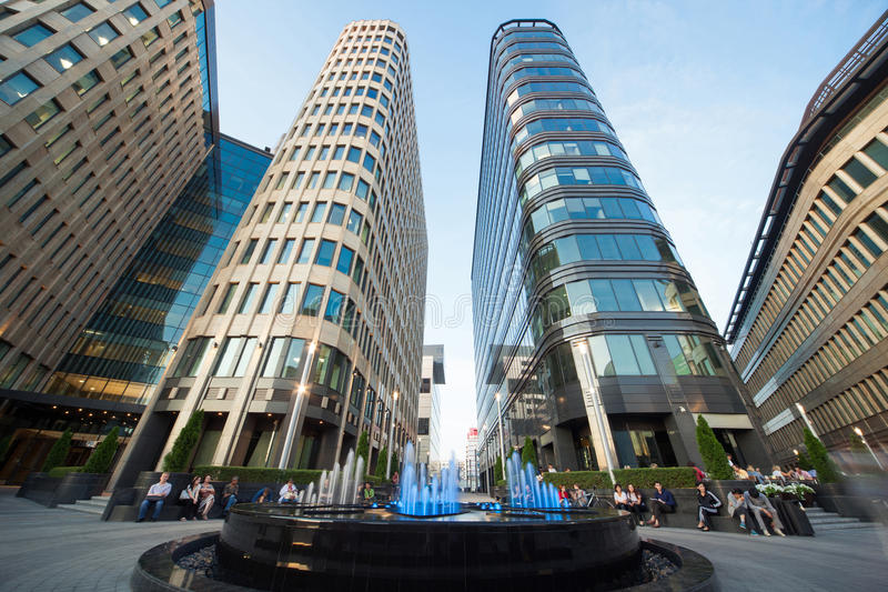 People have rest near fountain and Moscow business center stock photography