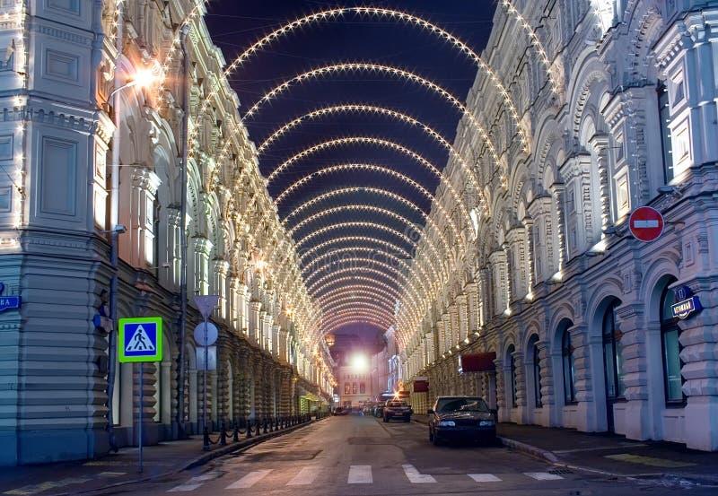 Moscow Christmas illumination. Old historical architecture in Moscow: Vetoshny pereulok (Vetoshny lane) in Moscow at winter night with Christmas illumination stock photos