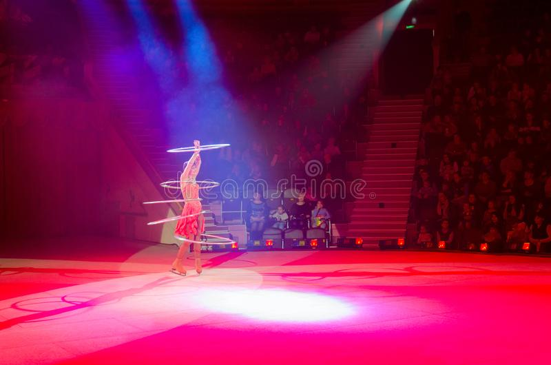 Moscow circus on ice on tour. Actress of troupe presents number Game with hula hoops stock images